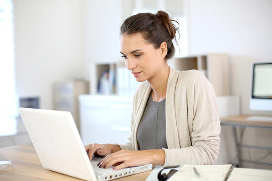 Attractive woman working in office on laptop-1