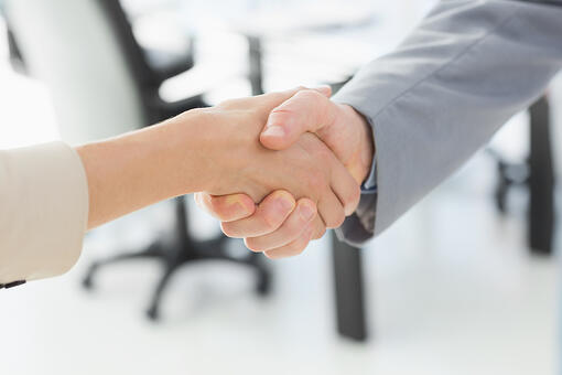 Close-up of shaking hands after a business meeting in the office
