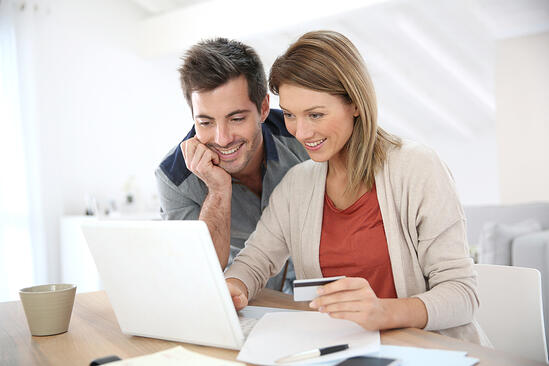 Couple at home buying on internet-2