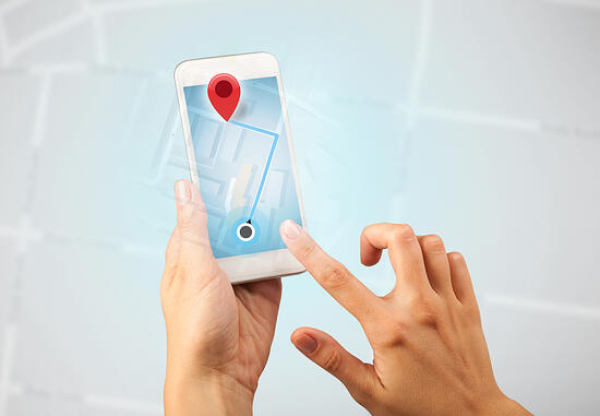 Female fingers touching smartphone with map