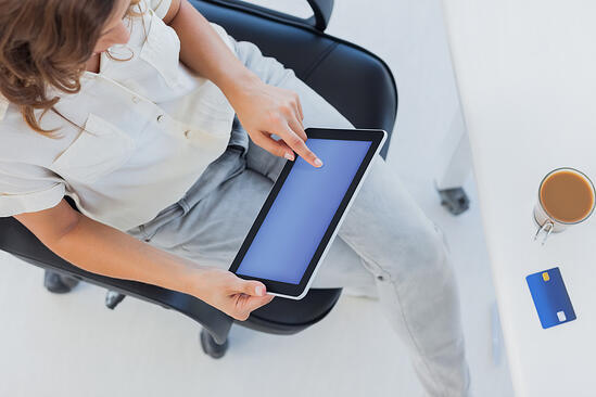 Overview of a designer using her tablet pc in her office